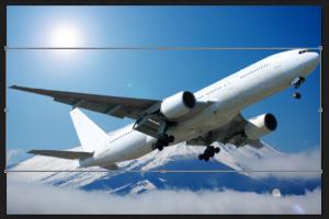 富士山を背景に飛ぶ飛行機の合成写真